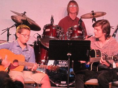 One of Norman Music Institutes Rock Bands performing during a monthly music showcase