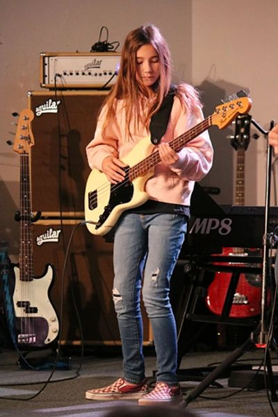 Young Female learning to play Bass at the Norman Music Institute