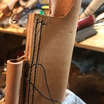Hand made and stitched leather sheaths.