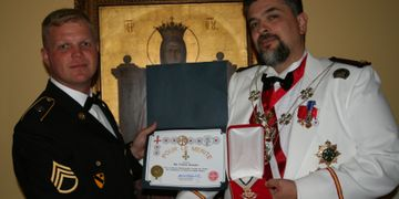 Sargent Breeden formally presented with the Pour le Merite by HSH Douglas Bailey.