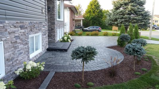 Barrie stone work landscape  front porch  front entry landscaping  stone step Tough Oaks Landscaping
