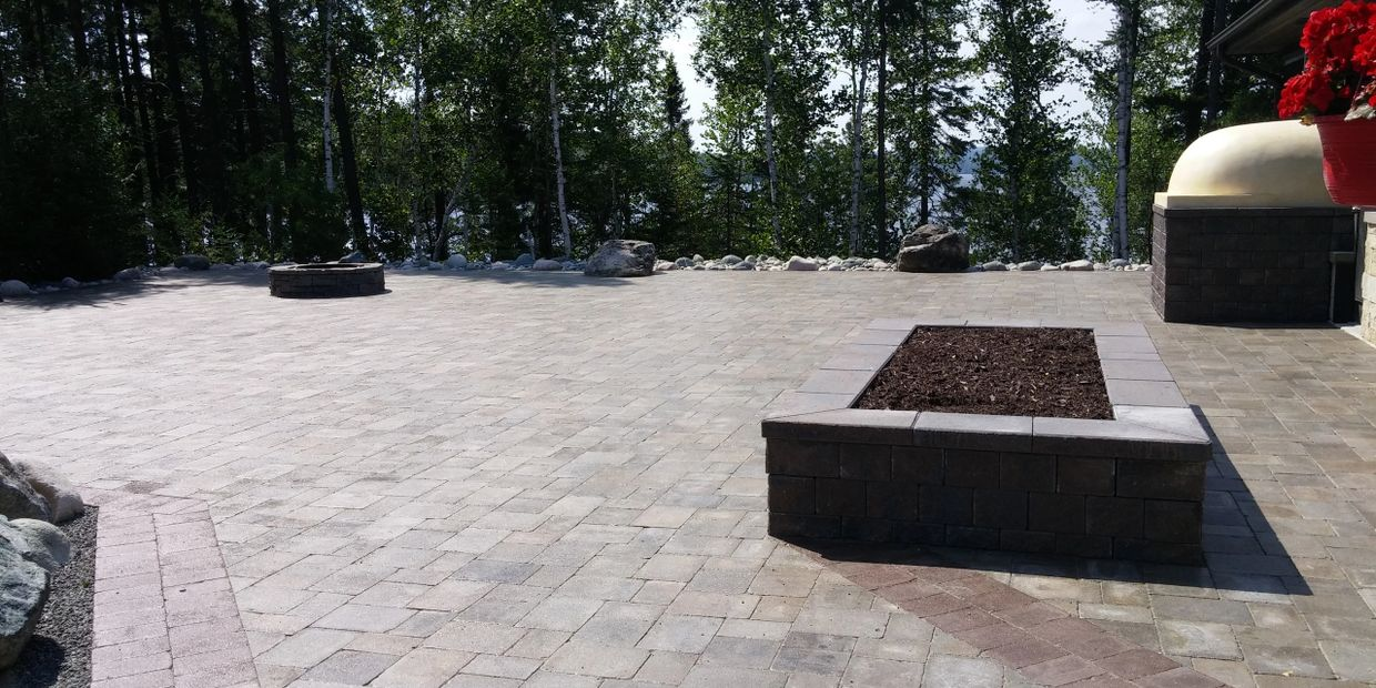 Tough Oaks Landscaping Company Barrie Natural Stone Patio features fire pits, pizza oven garden bed