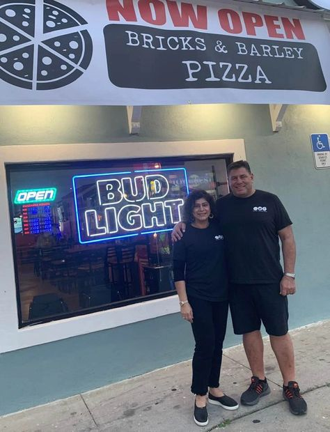 Proud new owners of the best pizza place on the beach.