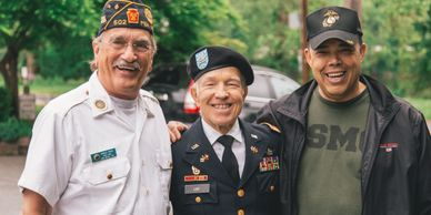 Image represents Veterans Care showing an elderly veteran smiling for photo.