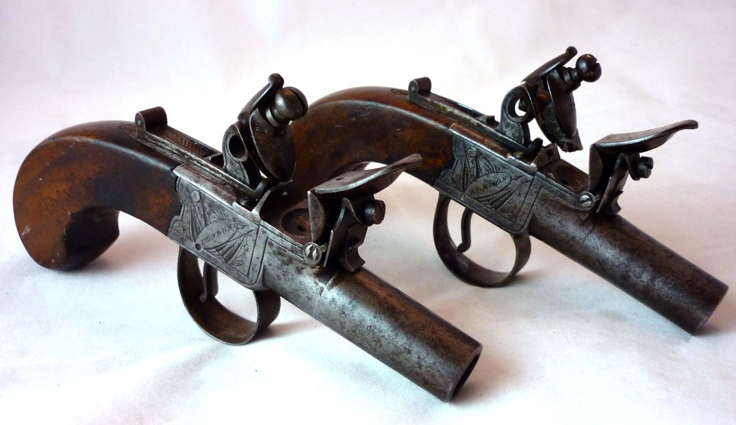 A good quality pair of 48 bore flintlock pocket/muff pistols by W Richards circa 1815