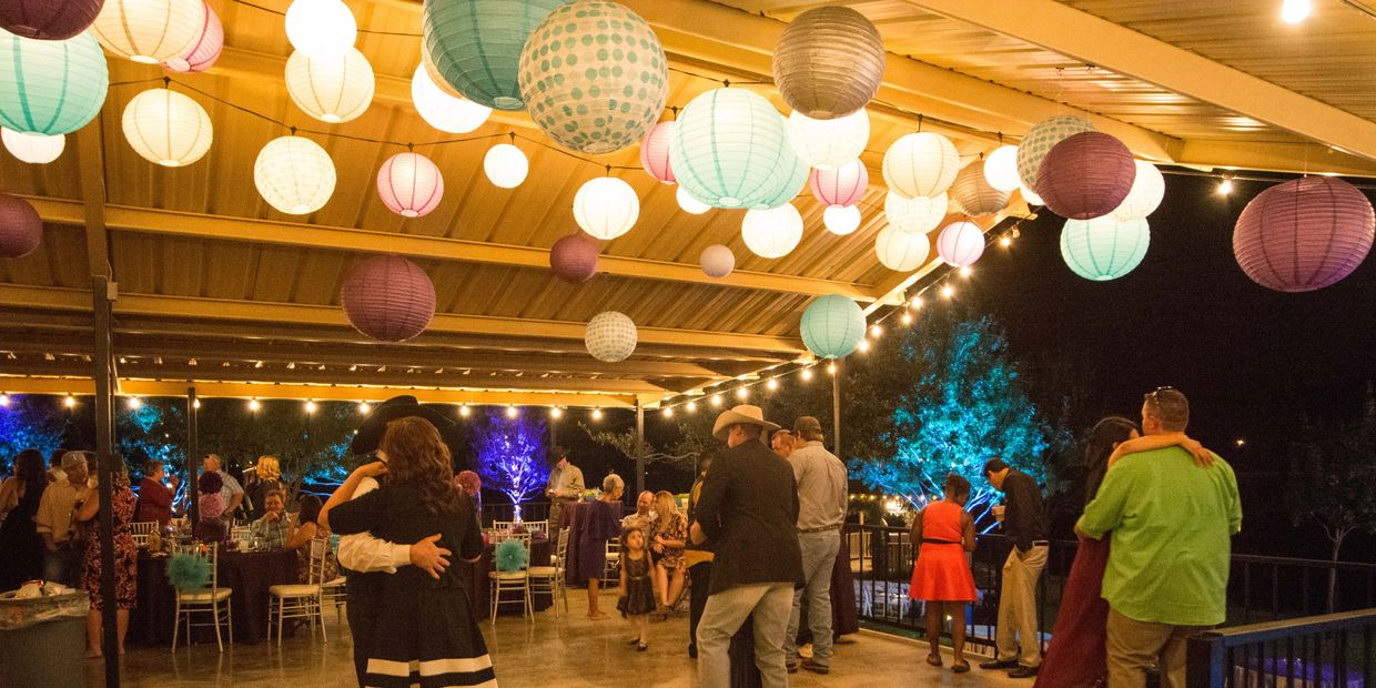 Dancing on the patio at a wedding reception  at Cain's Cove on Lake Nasworthy in San Angelo Texas