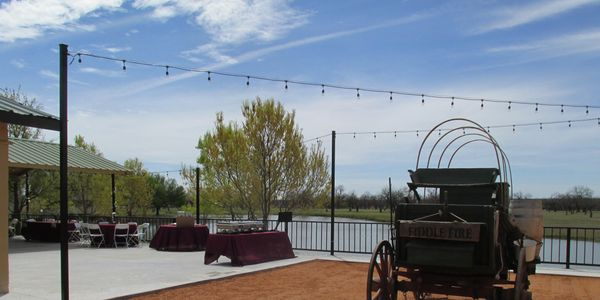Fiddle Fire Catering in the courtyard at Cain's Cove Wedding Venue on Lake Nasworthy in San Angelo