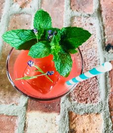 Watermelon Gimlet with fresh herbs.
