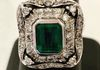 Approximately 2.00 ct. green Emerald flanked by approximately 1.00 ct. of diamonds set in 18KWG.