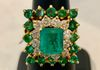 18 KYG with approximately 2.00 ct. Emerald center, 0.75 ct. in Diamonds and 1.00 ct. in side Emeralds