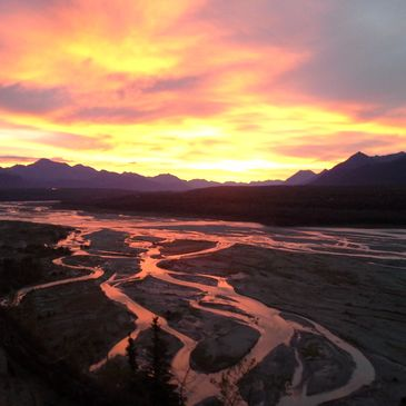 This is a sunrise over the Chugach Mountains with the Matanuska River in the foreground. This is abo
