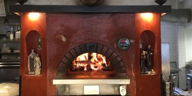 Pizza oven with a fire