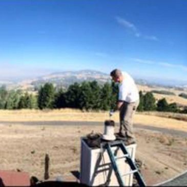 Chimney sweeping overlooking Sonoma County, Ca.