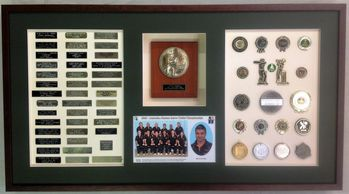 A life's collection of trophy plaques