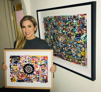 Virginia Casey with two of her plastic from the beach artwork