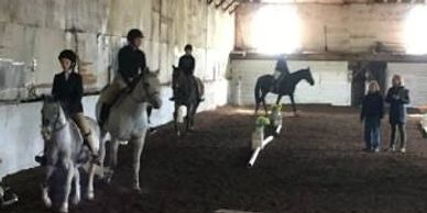 riders in the indoor arena