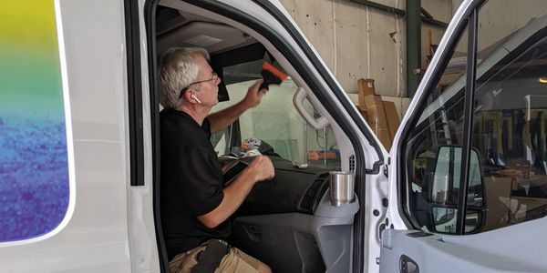 Steve expertly installing a windshield strip on a 2010 Ford Transit Van