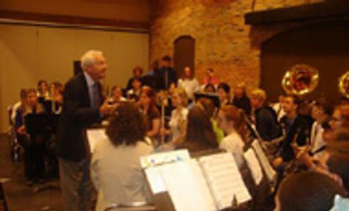Col Hal Gibson performs a clinic with a high school concert band.