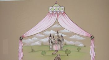 castle with soft pink drapes in a girls room.