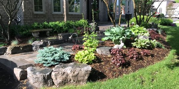 Beautiful residential landscaping design flowers green trees nursery plants rock custom professional