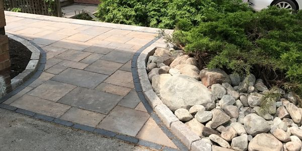 landscape design commercial residential property construction retaining wall walkway plants helpful
