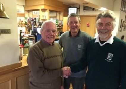 Ken Hopkins being congratulated by Tim Hartley and Graham Evison