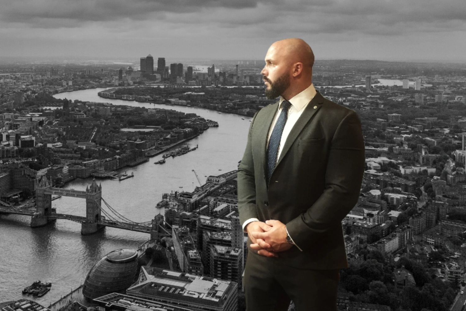 A male Close Protection Operative (Bodyguard) in a suit overlooking London city. UHWN protection.