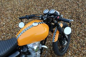 Kawasaki W800 Custom build with orange paintwork with chequered pattern by ASE Custom motorcycles