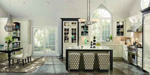 White painted kitchen cabinetry with Ebony contrast features. Merillat Masterpiece Cabinetry.