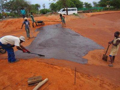 Workmen applying an Ecobond Membrane