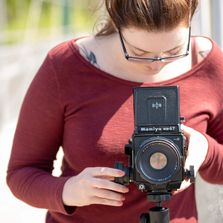 Photographer Caitlin Bevacqua takes a photograph with her vintage 120mm film camera.