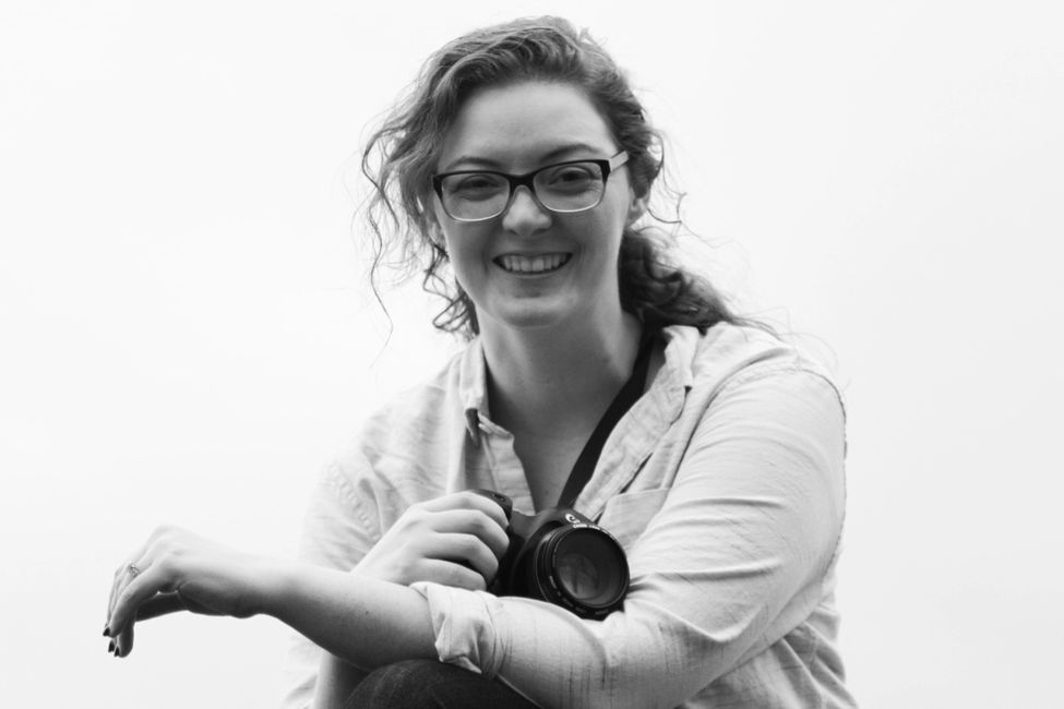 A photograph of photographer Caitlin Bevacqua of ill Pro Photo.