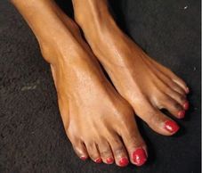 The nice feet and red toes of Miss Jeni Lynn from Amarillo.