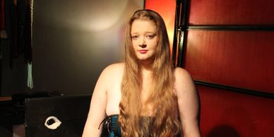 Miki Beth from Amarillo and her nice long hair in a blue and black corset.