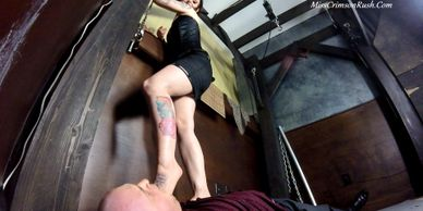 Miss Crimson Rush probing the depths of some lucky boy's mouth with her size six feet.