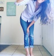 A tantalizing teasing glimpse of Okie Toesies looking comfy in some rolled up jeans and her cruelly cropped bare feet.