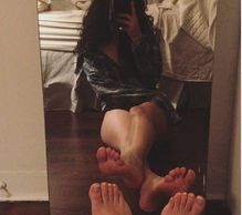Luna La Pisces takes a mirror selfie to capture the french tipped toes and nice arches and soles of her size seven bare feet.