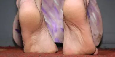 The exquisite soles and arches of a barefoot and up on her toes Lavon James.