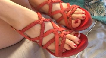 Some cool sandals on the nice red long toed feet of Miss Zoe Kate.