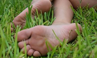 Rose relaxing in some nice, soft grass in her pretty bare feet.