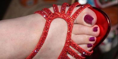 The right dark red toed toes and foot of Amarillo's Mirage in a sparkly open toed red heel.