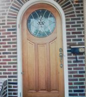 Mahogany round top door with custom leaded glass