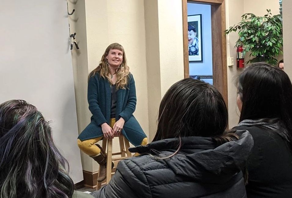 Speaking to an audience in Feb. 2020 about trauma, healing, and writing