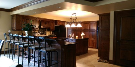 Kitchen Renovation in Windsor Ontario with custom cabinates, bar and custom millwork.