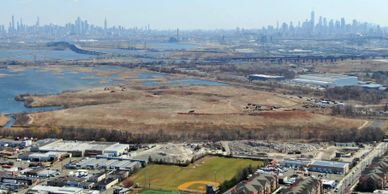 Keegan Landfill with sports field, Harvey Field and the New York City skyline.