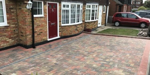 Bradstone driveway blocks in the colour of autumn with a red colour border.