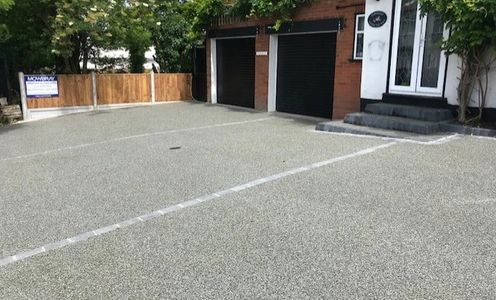 Resin Bound Driveway in silver blue colour.