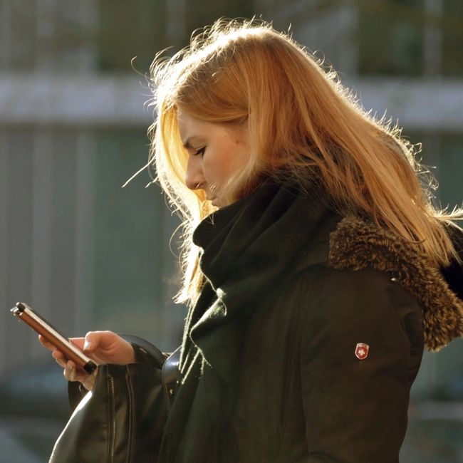 picture of a woman looking at a smart phone