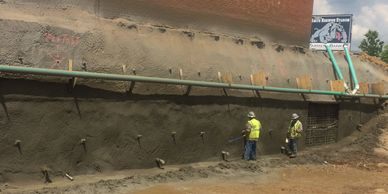 Shotcrete faced soil nail wall for excavation support (SOE).  Greenwood High School Freshman Center.