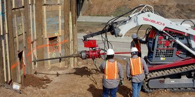 Installing a helical tieback for excavation support at the Mill Creek Bridge in Arkansas.
